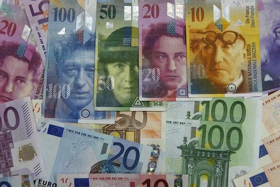 Fallout from Switzerland's wildly swinging currency ricocheted around the world, hitting global banks with tens of millions of dollars in losses and triggering the collapse of some brokerage firms.
