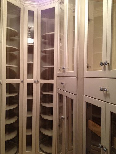 Unique idea for a walk in closet.  Lazy Susan's for purse and shoe storage! Lined drawers for jewelry. Love it.