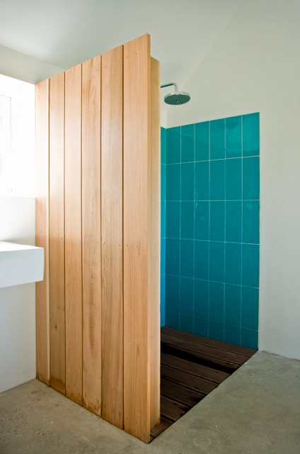 Interesting wood clad shower. Check out the site:   youaretheriver.com