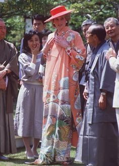 May 9, 1986: Princess Diana is helped by city officials to wear a Japanese Kimono during her tour of Nijo Castle in Kyoto, Japan..