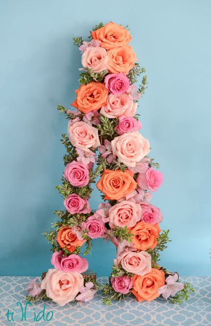 BIG S or SOFIE covered in pink flowers…hanging behind sweet table or above gift table outside Flower rose letter at a Pretty Pink Birthday #pink #birthday
