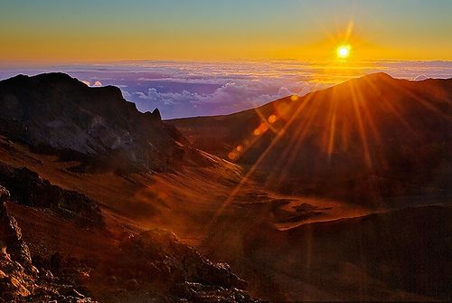 """Sunrise at Haleakala. We honeymooned in Maui (in 1996) and this was a highlight of that trip. It is so dark that you can't see your hand in front of your face, and freezing cold, but when the sun rises up over the crater, it is one of those """"I feel so insignificant in the face of nature"""" moments."""