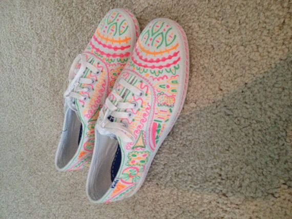 White keds with sharpie designs.