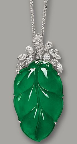 JADEITE 'LEAF' AND DIAMOND PENDANT NECKLACE Highly translucent jadeite carved as a 'leaf' and embellished by diamonds, mounted in white gold. Sotheby's.