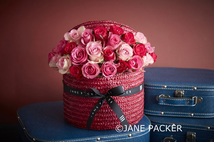As a St Valentine special, we've added this scarlet starlet to our Original Jane Packer Hatbox collection. As always filled to the brim with a selection of perfect pink Roses