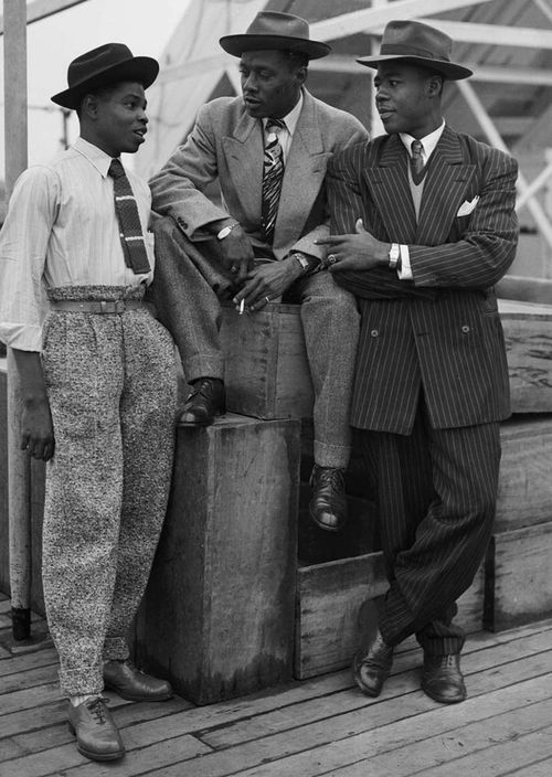 Zoot Suits, 22 June 1948. Three Jamaican Immigrants (left to right) John Hazel, a 21-year-old boxer, Harold Wilmot, 32, and John Roberts, a 22-year-old carpenter, arriving at Tilbury onboard the ex-troopship Empire Windrush, smartly dressed in zoot suits and trilby hats.