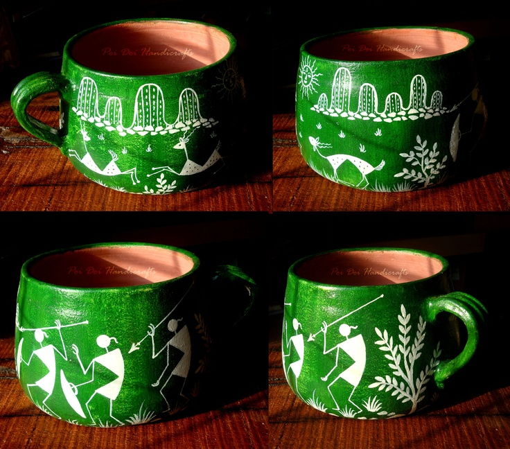 """A beautifully hand-painted mug in ancient Indian Tribal """"Warli Art"""" , bright green background represents the lush green forest which existed abundantly many years ago, tribal men and animals painted in white show hunting activity, which was one of the daily activity carried out to bring in food."""