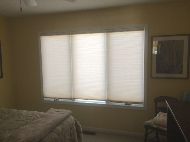 ASAP Blinds | Honeycomb shades in a bedroom provide just the right touch of privacy and shade.