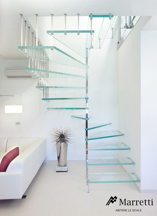 Spiral staircase with a square shape with extra-transparent structural glass steps