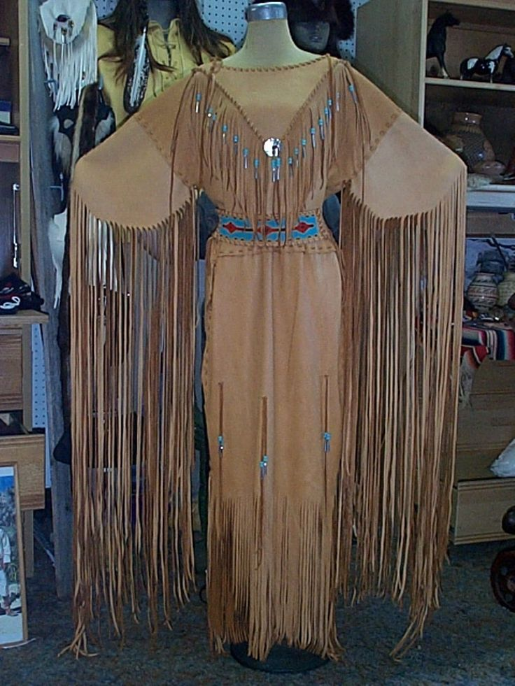 Gold deer hide dress with lazy stitch beadwork belt, glass beads and tin cones and an abalone disc. http://nativeamericanstuff.net/Native%20American%20Style%20Crafted%20Clothing%20buckskins%20outfits%20moccasins%20and%20Handbags.htm