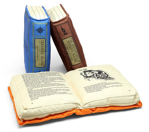 Pillows shaped like your favorite classic books: | 28 Cozy Things You Need For Your Bedroom