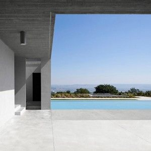 OSA submerges concrete home in a hill above Italy's San Giuliano lake