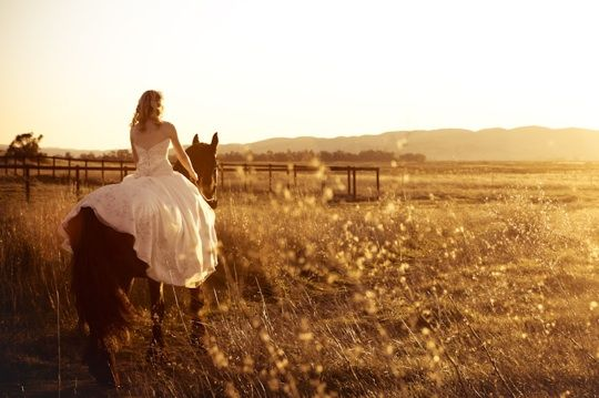 <3 I will ride in on a horse before walking down the isle!!