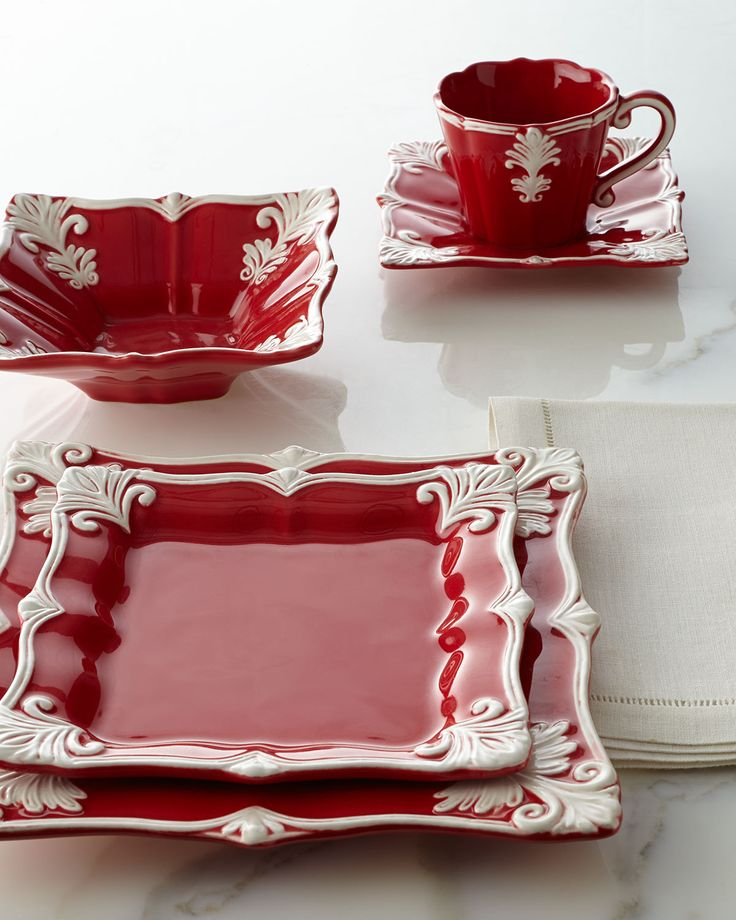 Exclusively ours. Beautifully detailed dinnerware features a unique square shape and an ornate Baroque design dressed in red for the holidays.