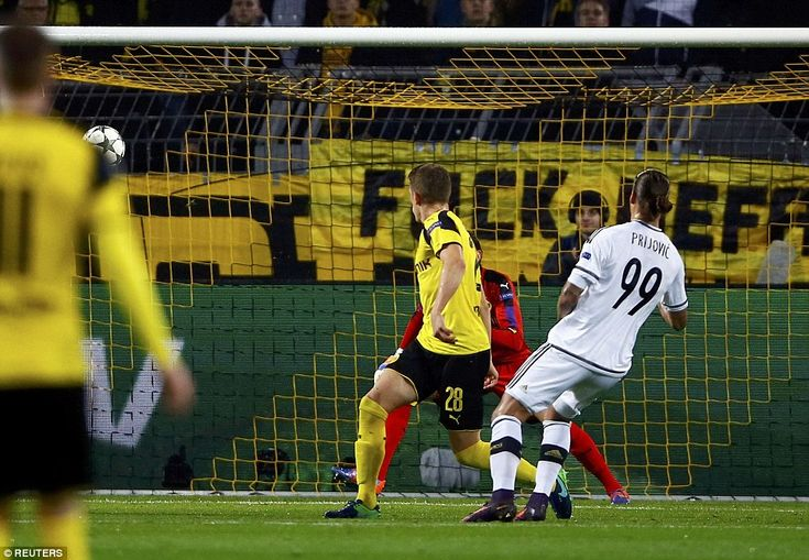 Aleksandar Prijovic watches as his curled effort gives Legia Warsaw a surprise lead with a fine strike after 10 minutes