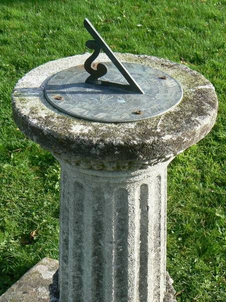 An Antique Purbeck Stone Sundial The Bronze Plate Mounted
