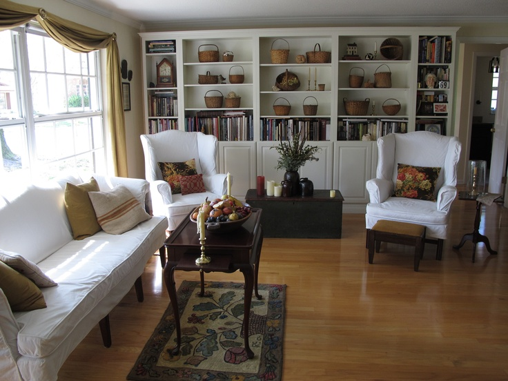 Living Room in Summer...white slipcovers & baskets