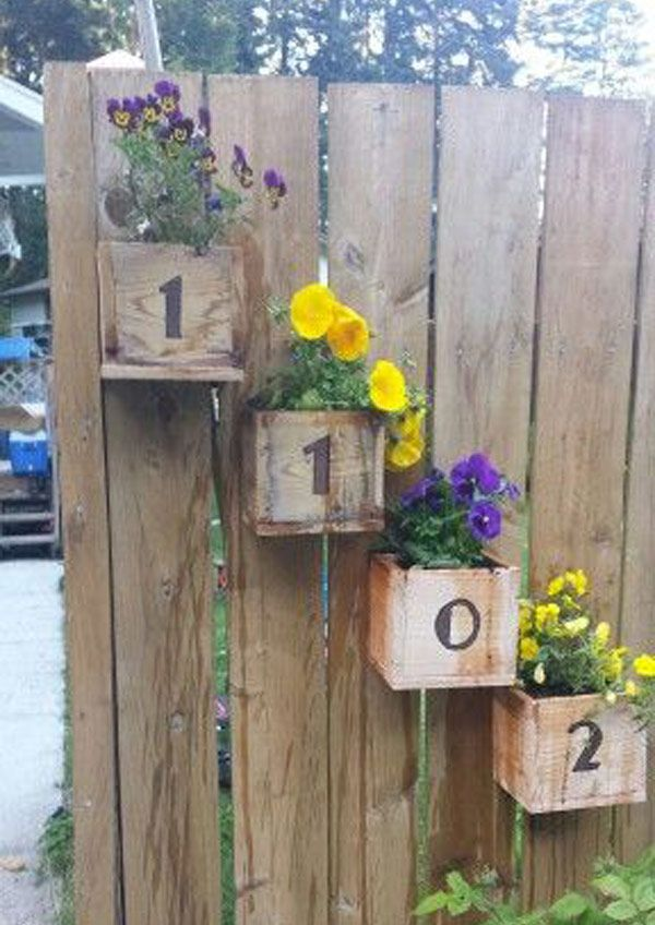 Cedar fence-post planters with house numbers