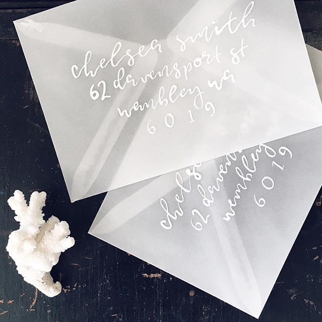 In the studio with paigetuzee designs white calligraphy
