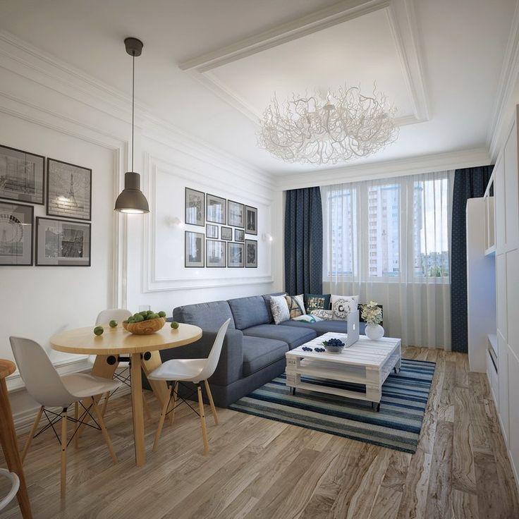 déco salon gris blanc bois : table ronde, chaises scandinaves, moulures en bois massif, lustre aérien et tapis rayé