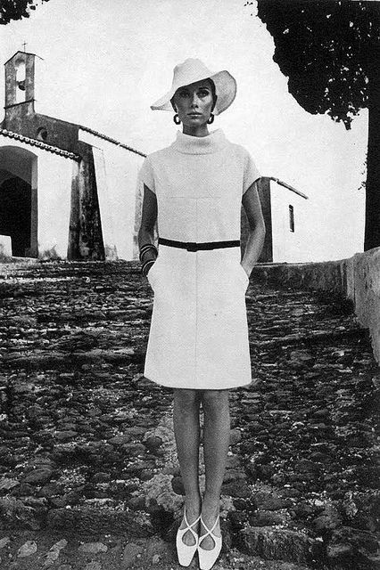 Nina Ricci    Model Maud Adams is wearing a dress by Nina Ricci and Roger Vivier for Christian Dior shoes.Photo:Helmut Newton.  UK Vogue,May 1966.
