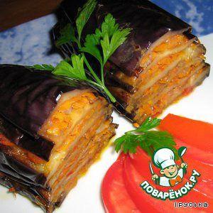Berenjena en turco Descripción: berenjena con tomates, zanahorias y cebollas cocidas al horno en el horno. Uuuum que buena.