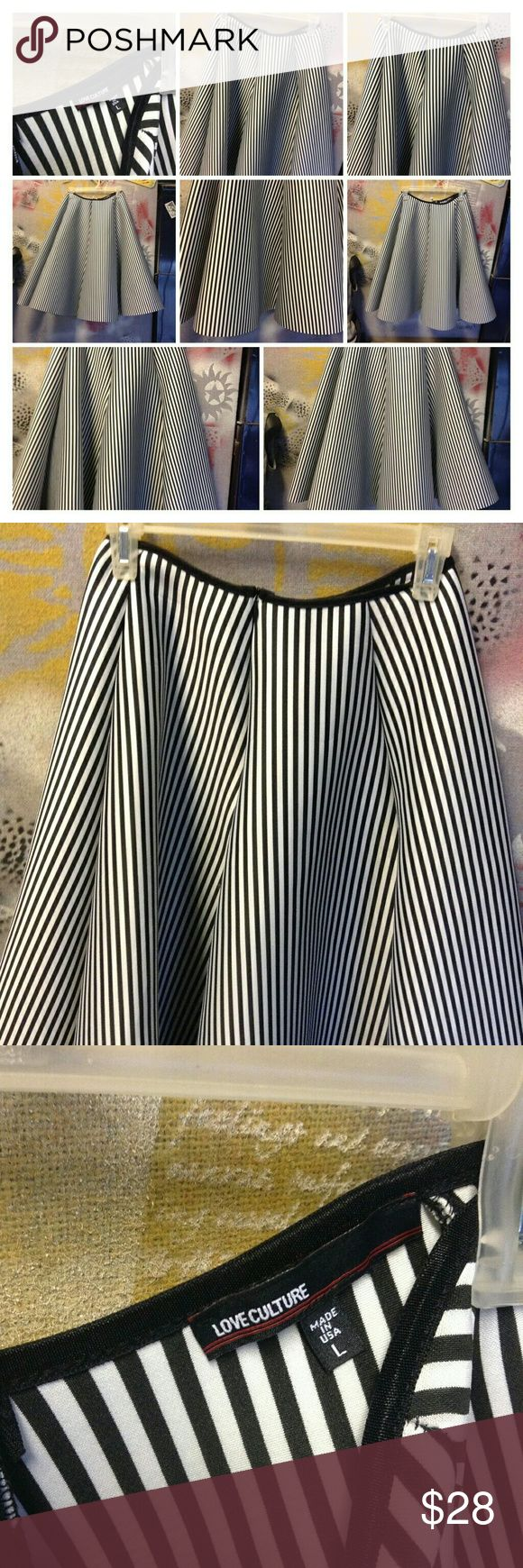 LOVE CULTURE  black & white pin stripped skirt M WOW! This skirt is amazing! Big flowing flare totally like 50's retro. Pair of Bobby socks and then black and white shoes my grandma wore when she was a kid.  Black and white pin stripped. Size M  95% polyester 5% SPANDEX made in USA Love Culture Skirts A-Line or Full
