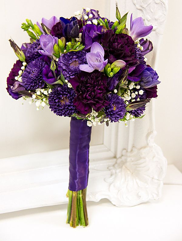 Local Wedding Expert Tina Riddell at Living Fresh in Kitchener, ON made this stunning purple bouquet!