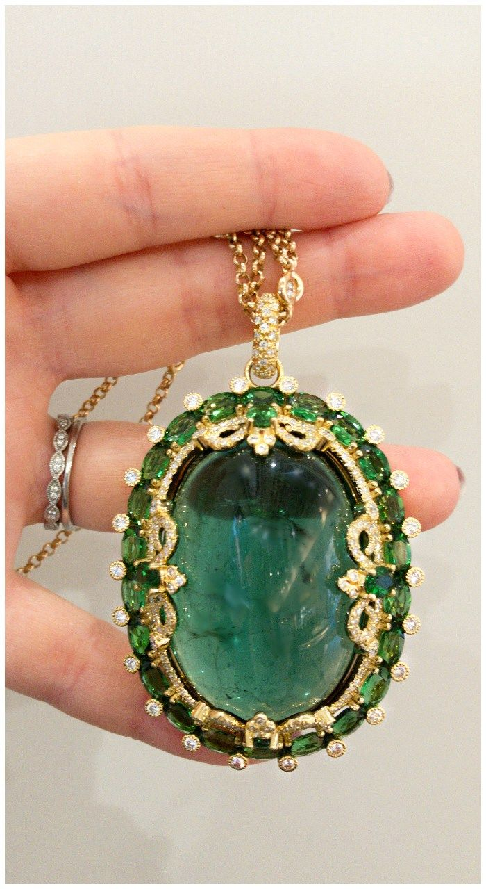 An incredible tourmaline cabochon pendant necklace by Erica Courtney.