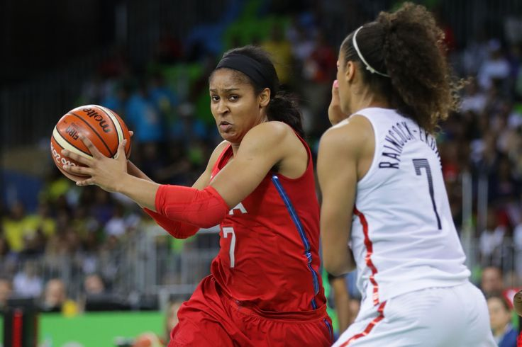US women's basketball routs Canada 81-51, clinches Group B:  August 12, 2016  -     United States forward Maya Moore (7) dribbles the ball as Canada forward Nayo Raincock-Ekunwe (7) defends during the women's team preliminary in the Rio 2016 Summer Olympic Games at Youth Arena.