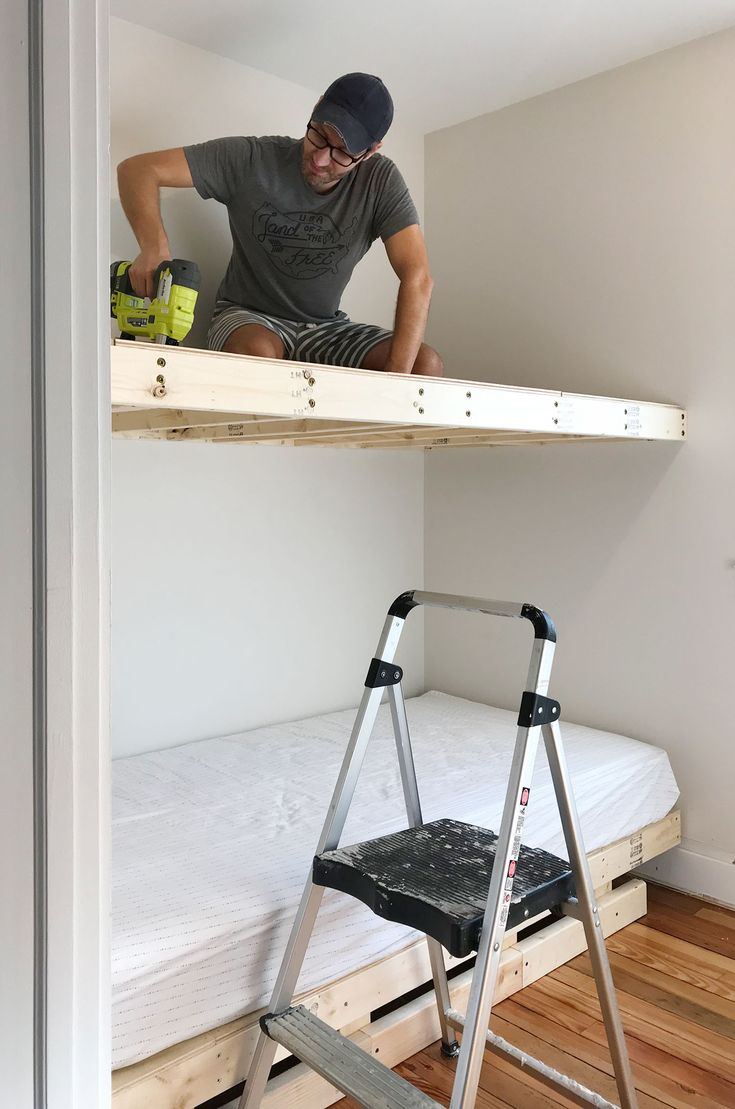 See how we constructed built-in bunk beds, including a ladder and railing, by building simple floating platforms for two twin XL mattresses.