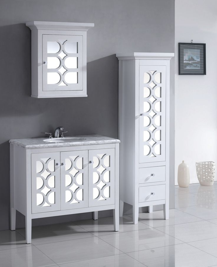 Made Of Solid Wood This Cabinet Features Ample Storage Space And A Moroccan Inspired Mirrored Door