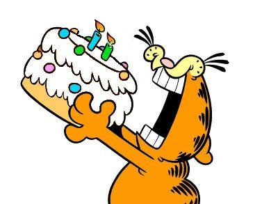 Garfield eating his birthday cake...candles and all
