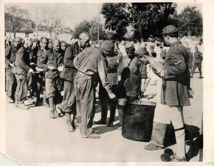 1940- Stew is dished out to captured Italian soldiers at an undisclosed Greek prison camp.
