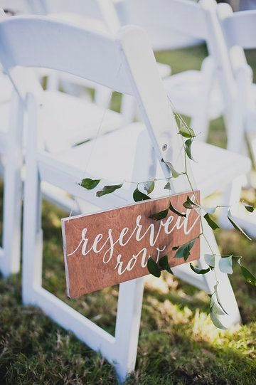 PRODUCT INFO: Reserved Row hanging chair sign. - Each sign measures approximately 11x5.5 - Small drilled holes in top corners with hemp string