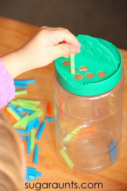 Tripod grasp with small pieces of straws and a recycled grated cheese container.