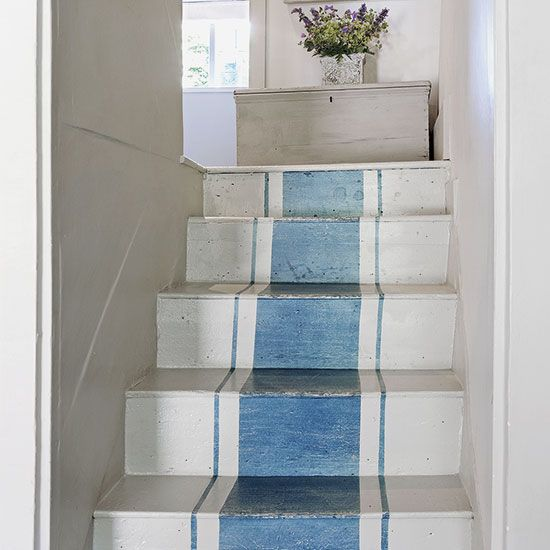 Paint a runner. Add a painted runner to a staircase in hard-wearing floor paints in sympathetic shades. A multi-stripe design will make narrow stairs in a country cottage seem wider. Experiment with widths and use masking tape to section off the areas you want to paint.