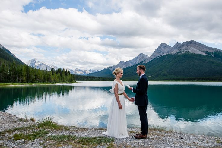 An elopement wedding on the shore of Spray Lakes, Kananaskis, not far from downtown Canmore, Alberta. A beautiful mountain lake wedding ceremony venue in the Canadian Rockies. Photo by one-edition.ca