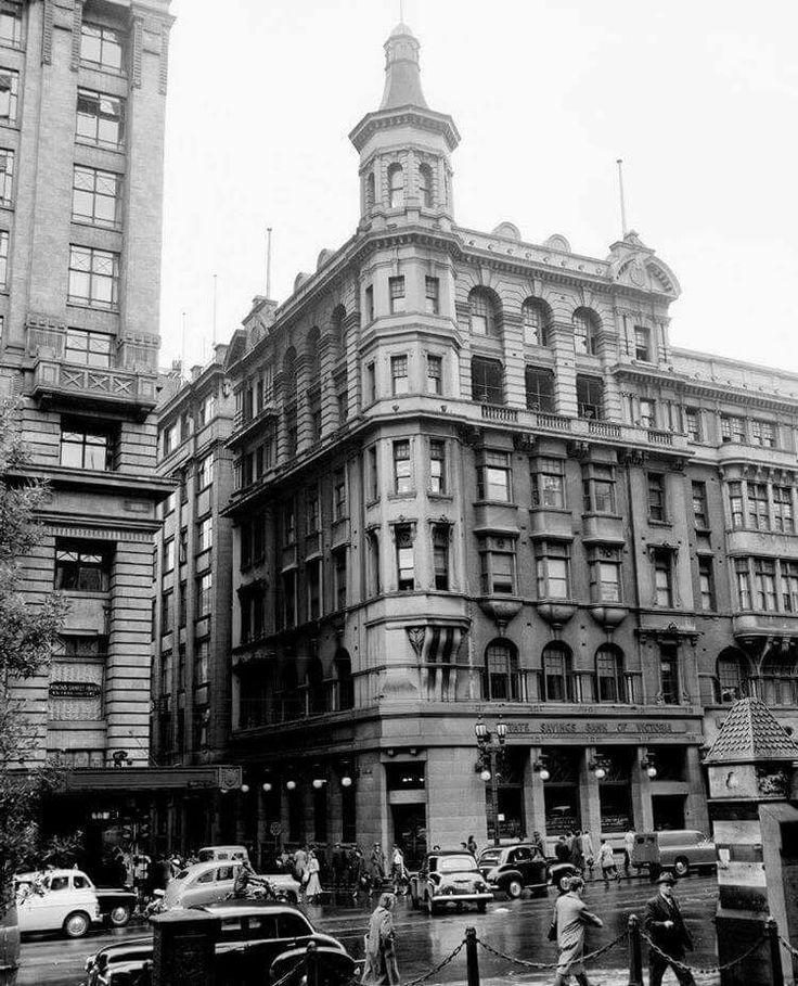 Champion Hotel corner of Flinders Lane & Swanston St Melbourne 1894 built in the American romaneque revival style with prominent corner turret. Bottom level became a Victoria State Savings Bank in late 50's with the original gasalier lights on the front of the facade.