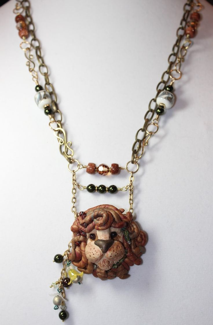 Sue Anzalone made the polymer clay lion!  great collection of beads from my partner.   Fun challenge!