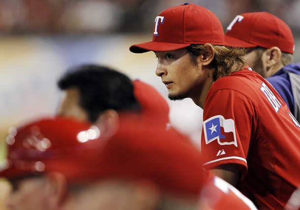 Texas Rangers starting pitcher Yu Darvish (11) watches from the dugout after being relieved in the eighth inning.–Special/Brandon Wade