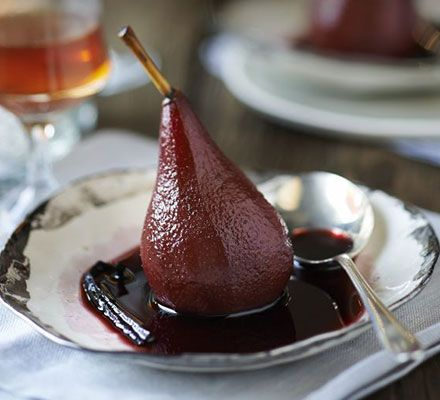 Whole poached pears make an elegant dinner party dessert, with a red wine sauce and fragrant cinnamon and vanilla