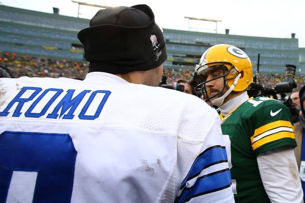 Tony Romo Photos Photos - Tony Romo #9 of the Dallas Cowboys congratulates  Aaron Rodgers #12 of the Green Bay Packers after the 2015 NFC Divisional Playoff game at Lambeau Field on January 11, 2015 in Green Bay, Wisconsin. The Packers defeated the Cowboys 26-21. - Divisional Playoffs - Dallas Cowboys v Green Bay Packers