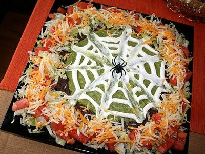 Halloween 7-Layer Dip :: Ingredients - 2 cans of Refried Beans 1 packet of Taco seasoning 1 container Guacamole 1 pint Sour Cream 1 can diced green chiles 2 tomatoes, sliced & chopped 1 bag Shredded Cheese. 2 cups shredded lettuce ~ Directions on this site.