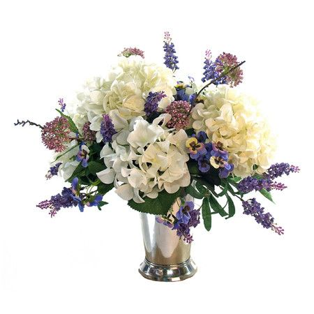 Faux hydrangea and pansy arrangement in glass vase.     Product: Faux floral arrangementConstruction Material: Silk, p...