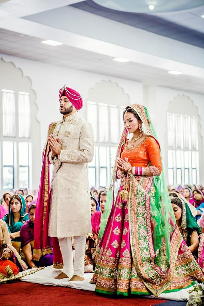 Sikh couple standing during Anand Karaj