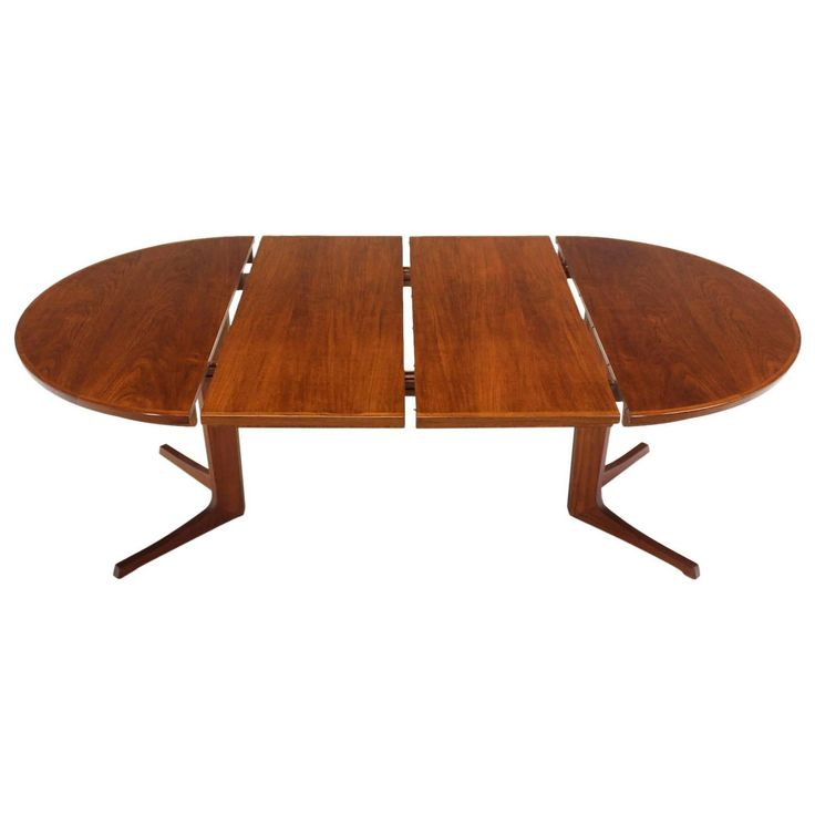 Round Danish Mid-Century Modern Teak Dining Table with Two Leaves | From a unique collection of antique and modern dining room tables at https://www.1stdibs.com/furniture/tables/dining-room-tables/