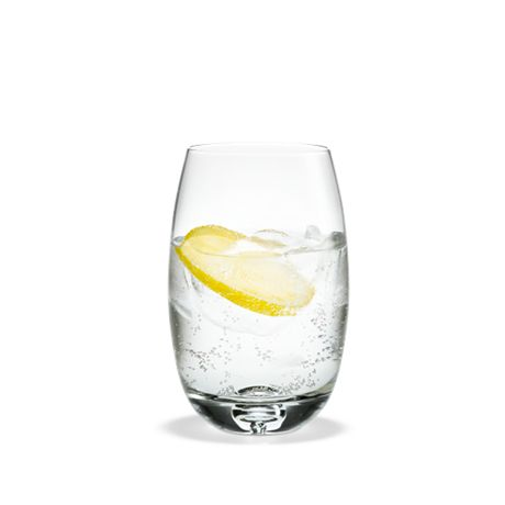 Serve an after-dinner drink in Michael Bang's large mouth blown long drinks glass from the Fontaine range or use it for colourful brunch smoothies.  #holmegaard #fontaine #longdrink