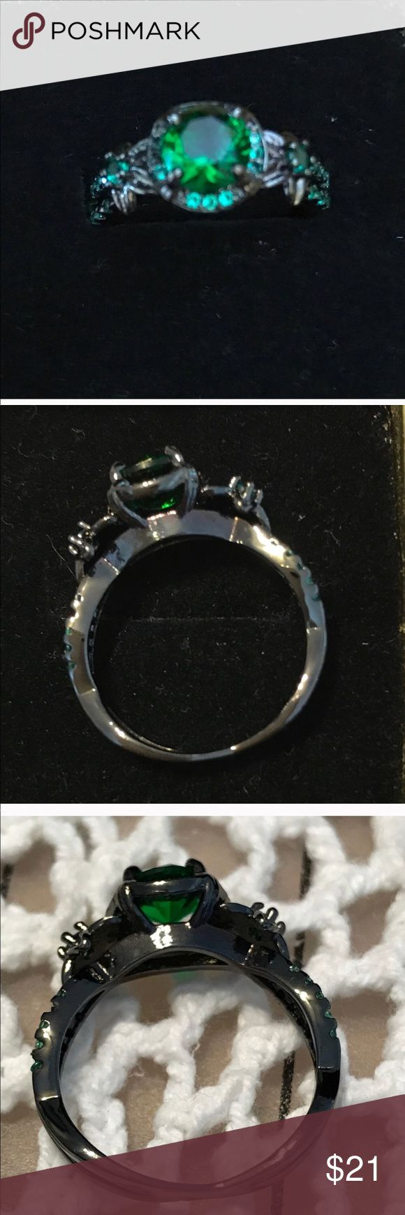~Green~ Emerald Green Size 7 Ring Beautiful faux emerald stones in a black gold filled setting. NWOT! 1 x 1 x .25 Inch  Thanks for ringing my closet! ✨💜Roni S/vmshk Jewelry Rings