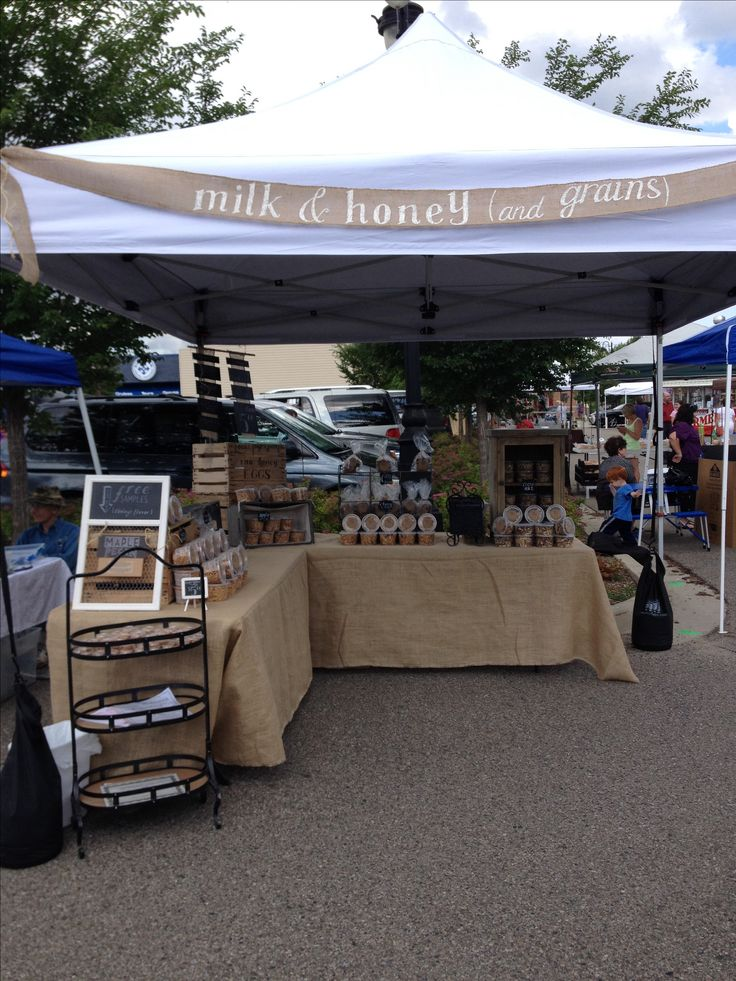 Milk & honey (and grains) farmers market stand. Burlap, weathered wood apple crates, and chalkboards used to display our healthy baked goods--granola and cookies.